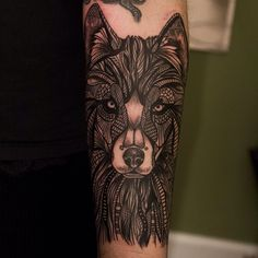 Graphic-linework portrait of a wolf as a forearm half-sleeve, done by Angel Antonio Morillas in 2014. Chicago, Illinois
