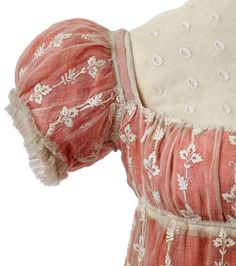 """Town dress with chemisette owned by Empress Josephine, First Empire  From the Chateau de Malmaision Costume Collection white muslin, embroidered with a sprinkling of flowers and embellished with a ruché trim. This outfit comes from the family of Madame Poyard who looked after the Empress's wardrobe after 1809."""""""