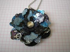 I think this is such a awesome idea. Recycled pop can flower necklace.