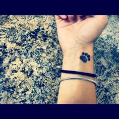 Wrist paw print tattoo for all the animal lovers :)  This is the tattoo that I want!!!!!!  Finally... it took me long enough to come up with a design that I would want forever... 19 years to be exact!!!  Love the paw print.