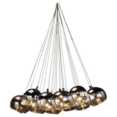 $535. Aquitaine &Co.  Maeve Chandelier I. Ten-light chandelier with round glass and metal shades.  Product: ChandelierConstruction Material: Glass and met