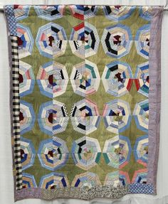 Spider Web variation, c. 1940-1970.  Made in Hard Bargain, an African American community (Franklin, Tennessee); collection of Roderick Kiracofe.  QuiltCon 2013 exhibit.  Posted at undercover crafter