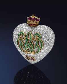 Emerald, ruby and diamond 20th anniversary brooch, mounted by Cartier, Paris, 1957 commissioned by The Duke of Windsor for the Duchess,  Wallace Simpson.