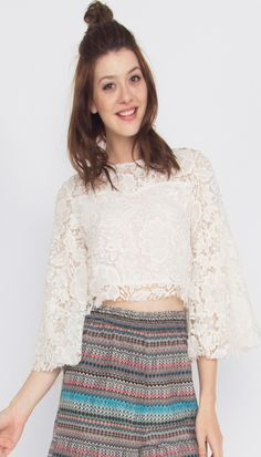 Little Lacey Top* This lace bell sleeve crop top is partially lined and perfect for festival season! Pair it with high-waisted cut offs and you're ready to go!