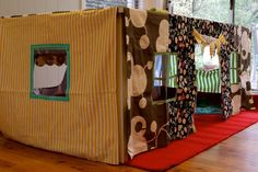 "Cut out ""windows"" from old sheets and hang over the kitchen table to create an instant fort!"