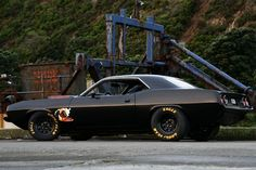 'cuda with the goodyear racing tires my god lol so nice