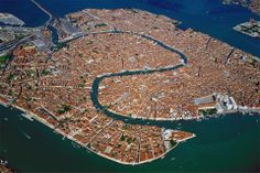 Venice, a city sited on a group of 118 small islands separated by canals and linked by bridges as seen from above. Photo by: Yann Athus-Bertrand