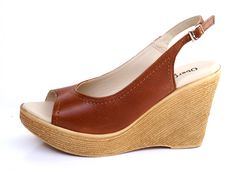 UberGruvi Genuine Leather Medium Wedge Heel Sandal - Texas Tan. R 779. Handcrafted in Cape Town, South Africa. Code: MAYA 01 Tan See online shopping for sizes. Shop online https://www.thewhatnotshoes.co.za Free delivery within South Africa.
