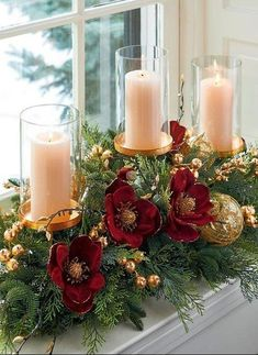 Realistic evergreen is brought to life with burgundy magnolias, gilded berries, sprigs of cypress, gold baubles and ornate ribbon. This candle holder embodies holiday elegance, bringing glamour to the home.