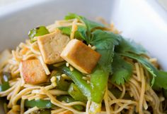 Your family will flip for this delicious Thai-inspired peanut, tofu and noodle dish. The pea pods, cilantro and scallions bring color and flavor to the peanut sauce, which is a great source of monounsaturated fat. Make it vegan if you like. Raw Food Recipes, Asian Recipes, Vegetarian Recipes, Cooking Recipes, Healthy Recipes, Ethnic Recipes, Delicious Recipes, Tasty, Bok Choy Stir Fry