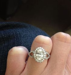 I WOULD DIE!! By FAR my fav ring...Love the oval with looped sides. Maybe even put pear stones inside the loops!