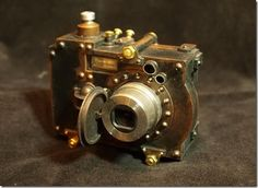 This is just a typical digital camera that's been housed in a very well executed steampunk styled case, created by Herr Döktor.