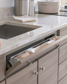 Every nook and cranny of the Maple Ave. kitchen offers a storage solution, like this tilt-down drawer for the kitchen sink. It's a super-convenient place to store odds and ends, like dish sponges and scrub brushes. Shop Martha Stewart Living Kitchens at The Home Depot