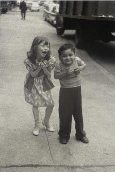 "Diane Arbus. This photo of the two children in the street really caught my attention. It shows the true nature of a child. Their care-free attitudes, their ""goofiness."""