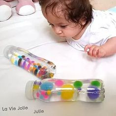 Sensory bottles for babies waterbased pompons beads Sensory Bottles for Babies Waterbased Pompoms Beads – Sensory bottles for babies waterbased pompons beads Sensory Bottles for Babies Waterbased Pompoms Beads – Montessori Baby, Montessori Activities, Infant Activities, Activities For Kids, Baby Sensory Play, Baby Play, Toddler Learning, Toddler Fun, Baby Lernen