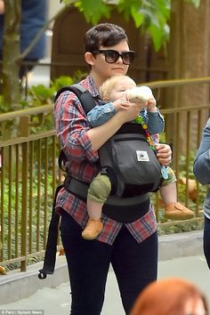The happiest place on earth! Ginnifer Goodwin dotes on her baby son Oliver as she and husband Josh Dallas spend the day at Disneyland