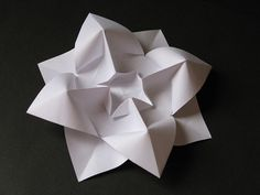 Fiore bombato - Curved flower. Origami from one uncut square of copy paper, 21 x 21 cm. Designed and folded by Francesco Guarnieri, March 2009. Crease Pattern: http://guarnieri-origami.blogspot.it/2013/03/fiore-bombato.html