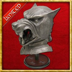 This wearable licensed fiberglass replica Hound's Helmet from Game of Thrones has operable jaw visor. Painted to resemble antique steel, a silk-screened wooden display stand with the Clegane sigil is included Historical Costume, Historical Clothing, Game Of Thrones Merchandise, Wooden Display Stand, Helmet, Lion Sculpture, Games, Antiques, Larger