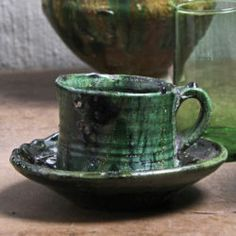 Tamegroute Teacup and Saucer Set – Green Saucer diameter: 16 cm Cup diameter: cm Cup height: Colour: emerald Material: Earthenware Handmade in Morocco Tea Cup Saucer, Tea Cups, Lush Green, Earthenware, Candlesticks, Im Not Perfect, Artisan, Ceramics, Traditional