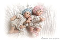 1:12th miniature porcelain twins by Doreen Sinnett in crocheted rompers and berets by Patti Highfill