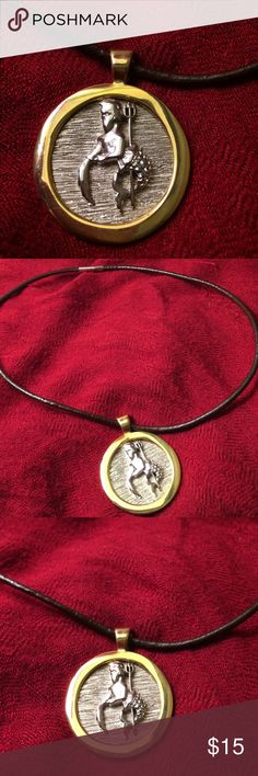 """Vintage """"Aquarius"""" Medallion Bought at a Flea Market in 1985. A 1"""" in Diameter medallion in gold and silver featuring the astrological symbol for Aquarius. This is a weighty medallion. I strung it on a brown magnetic cord. Vintage Jewelry Necklaces"""