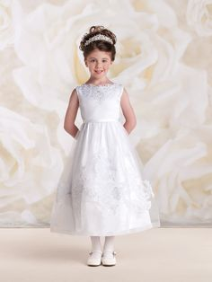 Sleeveless satin, tulle and lace tea-length full A-line dress, tulle over satin bodice accented with wide lace bateau neckline and satin waistband, tulle over satin skirt features matching lace appliqués and a narrow horsehair hem, ideal as a flower girl dress or party dress.NEW for Spring 2015: White.Sizes: 2 – 14