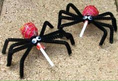 Lollypop spiders. Halloween candy suckers, pipe cleaner spiders.