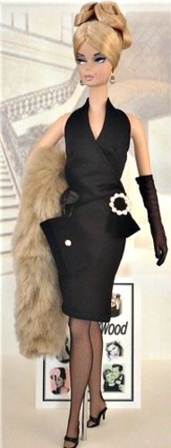 Barbie in Sophisticated UpDo Wearing LBD Sleeveless Dress with Circular White Buckle and Long Fawn Fur Wrap