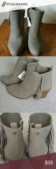 "Circus By Sam Edelman ""Lennon"" Fringe  Booties! Besutiful! NWT  ""Man made/Leather upper /Balance Man Made."" (This is what it states inside of shoe ) The outer  material appears to be Suede.  Its  Taupe/ Light Gray Shade,  Size 8.  Heel type - Block, Heel Ht: Approximately  (13/4 in to 2 3/4 in)  The boot is short, but does extend over my ankles.  I am 5 ft tall Please  review carefully,  no returns. Sam Edelman Shoes Ankle Boots & Booties"