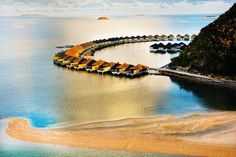 Stunning colours - a sunrise view of the water villas at Huma Island Resort and Spa, Palawan