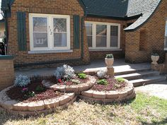 Tiered flower beds with brick borders