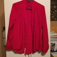 Red Express Wear to Work Button Up Great shirt to wear to work with a skirt or dress pants. Colored button up, to right in the arms for me. In excellent condition. Express Tops Button Down Shirts
