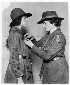 Here, Low presents a Golden Eaglet, the highest award in Girl Scouting, in the early 1920s.