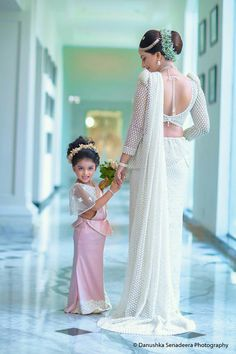 This little girl is giving us major goals! Witness the most here and slay with that perfect bun look! Bridal Sari, Indian Bridal Sarees, Bridal Dresses, White Saree Wedding, Wedding Gowns, Srilankan Wedding, Christian Bride, Bridesmaid Saree, Bridal Hairdo