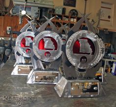 Custom steel trophies with accents of candy apple red & matte black. www.refinerii.net