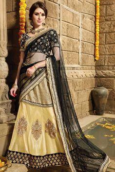 Black Dupion Lehenga And Net Choli Price:£79 Black dupion semi stictch lehenga choli. Embellished with embroidered, resham, zari and stone. It is perfect for festival wear and wedding wear. Unstitch blouse and 0.80 mtr Choli : 2.25 mtr Dupatta : 3 mtr Lehenga lehenga inner fabric is satin. http://www.andaazfashion.co.uk/womens/lehenga-choli/black-dupion-lehenga-and-net-choli-dmv8715.html