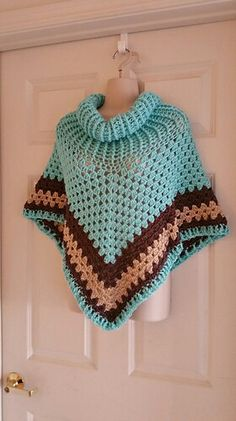 Hot Off My Hook! Project: Cowl-Neck Poncho Started: 03 Nov 2015 Completed: 06 Nov 2015 Model: Madge the Mannequin Crochet Hook(s): 7mm, Cowl Portion J, Granny Stitch Yarn: Caron Simply Soft Color(s): Robin's Egg, Taupe, Bone Pattern Source: Simply Crochet Magazine Issue No. 25 (Hard Copy) Pattern Designed By: Simone Francis Notes: This is my 45th Cowl-Neck Poncho! This is the 6th made with Caron Simply Soft! Another Christmas gift for my Son's Coworker!