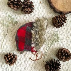 This faux fur–trimmed kids' bonnet will keep your little lumberjack as toasty as can be, all winter long.