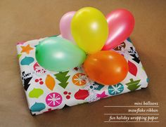 Use mini balloons as a present topper.  (It would also be fun to add money or small gifts inside of the balloons.)