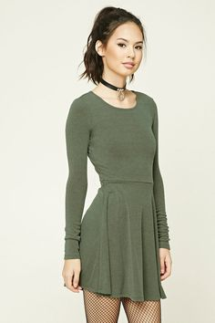 Style Deals - A heathered knit skater dress featuring a round neckline, long sleeves, and a flared silhouette.