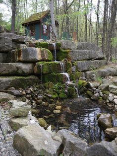 Outside is a two-story limestone waterfall that can