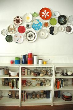 I like the idea of using plates as wall art, especially for those large awkward walls in dining rooms or kitchens. I like that this one includes some fun colors.