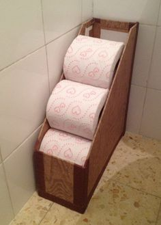 Repurpose a magazine rack to hold toilet paper rolls.