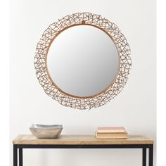 This unique handcrafted wall mirror can be added to any room that needs a touch of whimsy. The twig-like design that surrounds the mirror is handcrafted and authentic. It is made of durable copper to give a wood-like and fragile look.