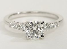 14k white gold engagement ring, showcasing pavé-set round diamonds along the shank and your choice of center diamond.