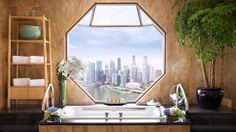 RITZ CARLTON SINGAPORE What a view! Many an hours could be spent simply gazing out to the city below….