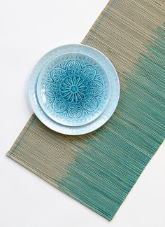 Layer a table with different shades of blue for a fun, elegant summer look. Seagrass table runner, $14.88; plates, $3-$3.50. Shop hometrends™ now at http://www.walmart.ca/hometrends | #patternedplates #tablerunner #decorating #outdoorliving #walmart #hometrends