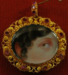 This stunning eye miniature is of a woman with hazel eyes and brunette curls over her temples. She is set in a spectacular gold cannetille work pendant frame set with rubies. Eye Jewelry, Enamel Jewelry, Antique Jewelry, Vintage Jewelry, Jewlery, Jane Austen, Memento Mori, Lovers Eyes, Miniature Portraits