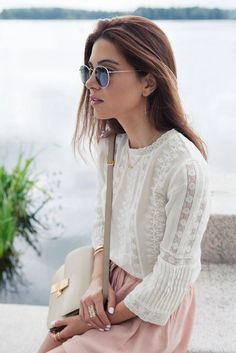 This light lace blouse and pretty pink skirt make me miss summer all over again. Absolutely in love with this entire ensemble.