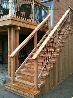 Stairs made of cedar wood and the railing are wrought irons. #Deck design #custom deck #interlocking #patio #Toronto